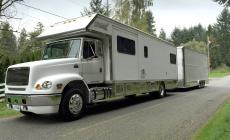 36ft RENEGADE MOTORHOME with 30ft STACKER TRAILER W/LIFT main photo